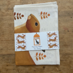 Hurrying Hares Tea Towel